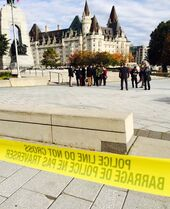 Police tape surrounds the Canadian War Memorial in Ottawa after a soldier guarding the monument was shot on Wednesday.
