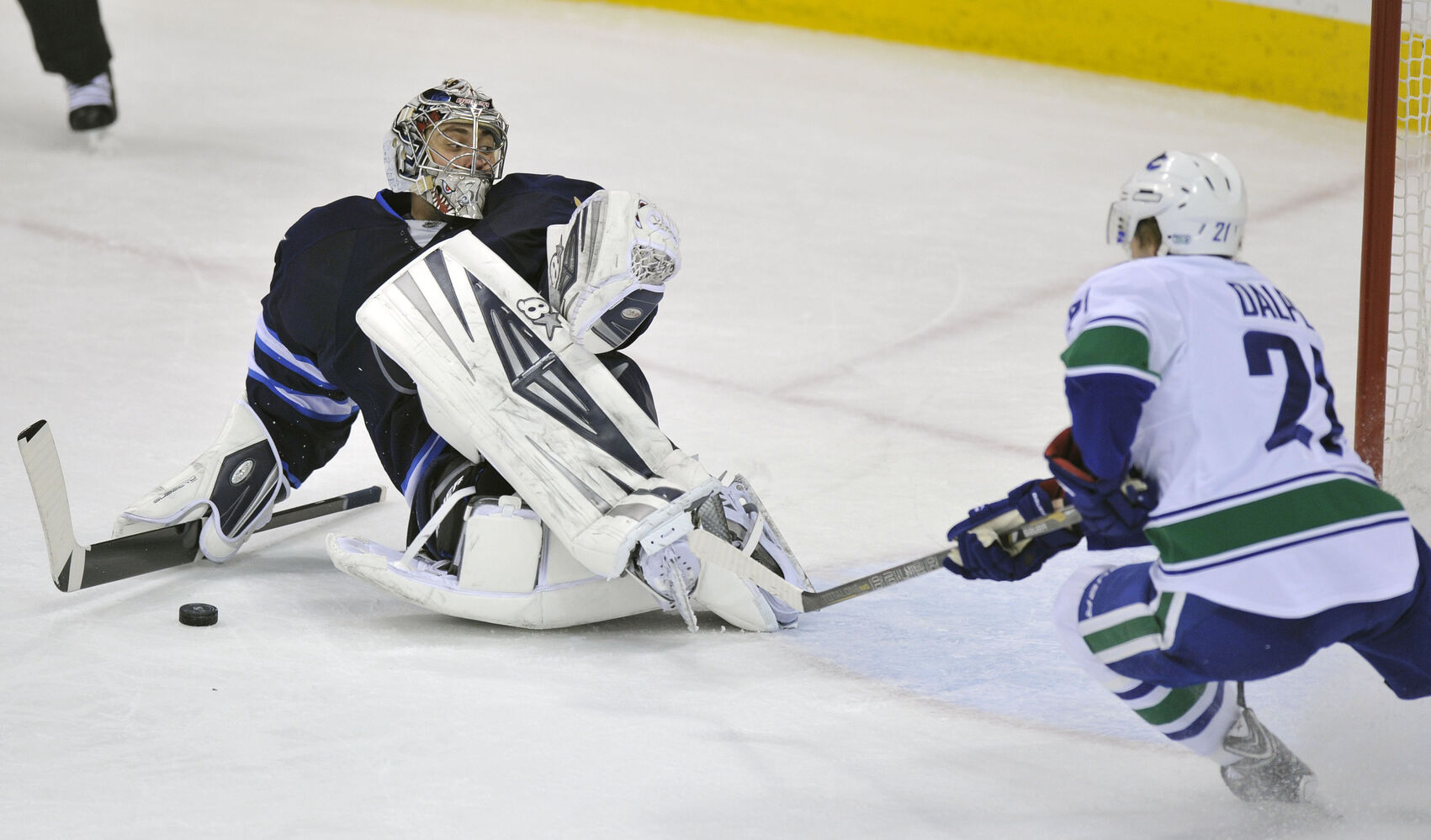 Winnipeg Jets' goaltender Ondrej Pavelec ties it up with  Vancouver Canucks' Zac Dalpe during second period in Winnipeg Friday.