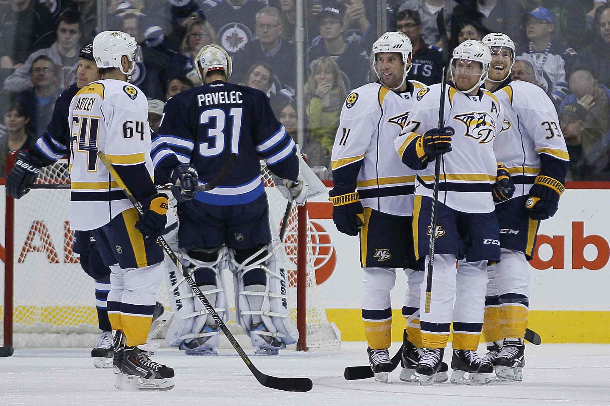 Nashville Predators celebrate Patric Hornqvist's (27) goal on Winnipeg Jets goaltender Ondrej Pavelec (31) during the second period.