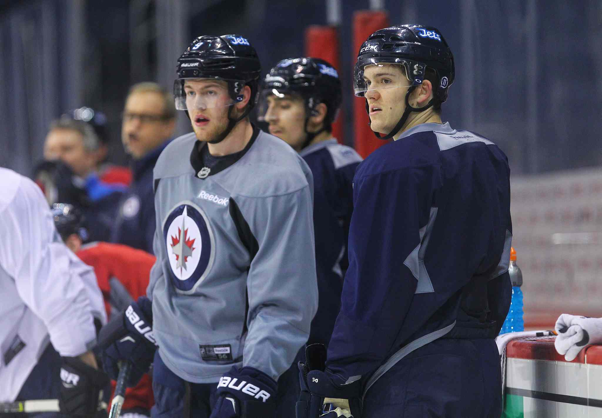 Winnipeg Jets' Jack Roslovic (52), right, and Andrew Copp (9) during spring practice eariler this year.