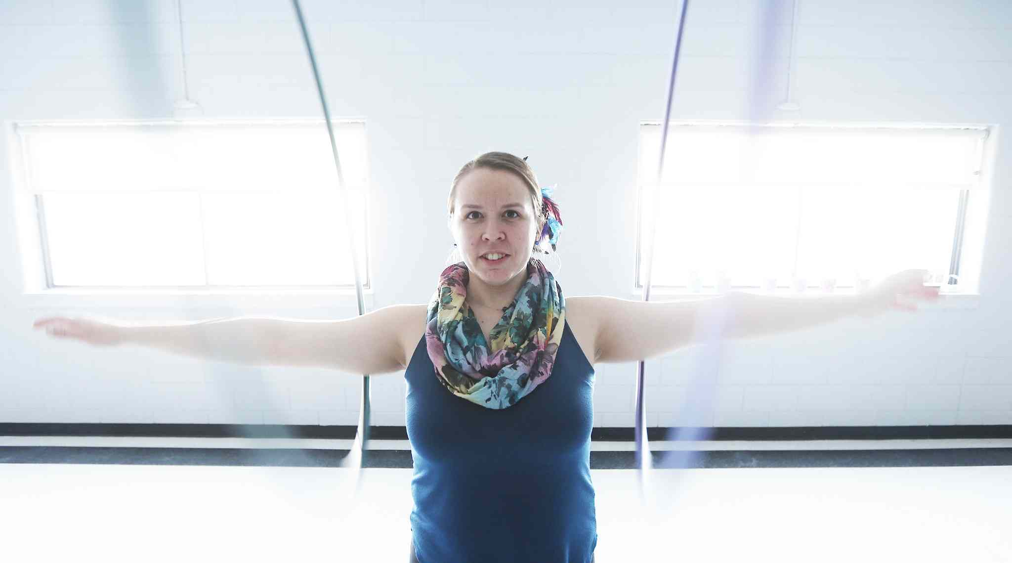 Karrie Blackburn, owner of Kurrent Motion, teaches an acrobatic hula hooping class at Valley Gardens Community Centre.