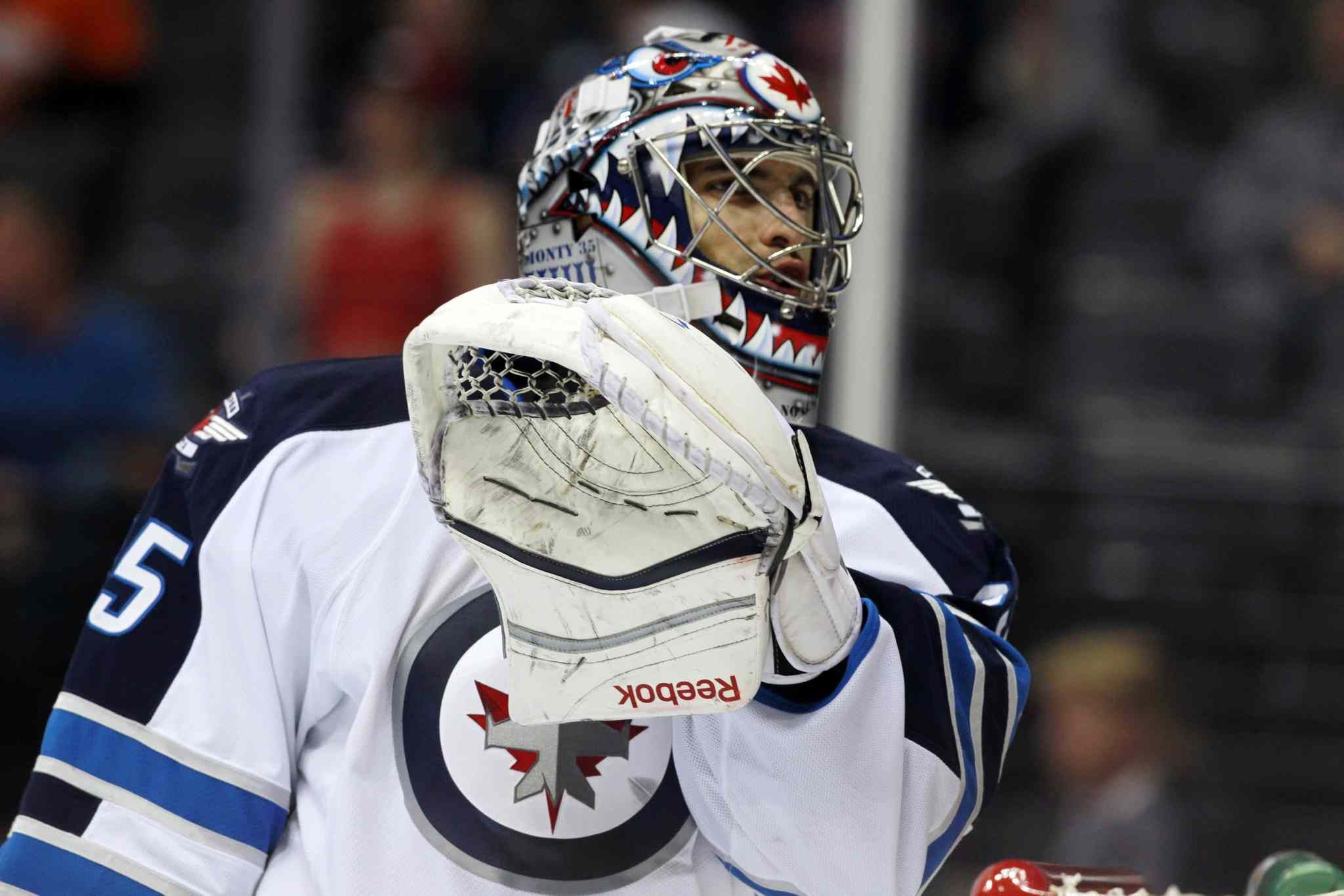 Winnipeg Jets goalie Al Montoya talks with a referee during a break in play in the second period.