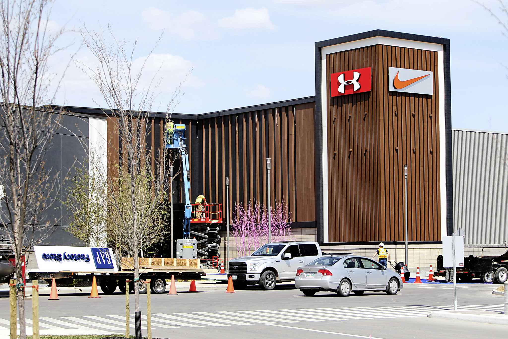 Workers put the final touches to the facade of the mall that will be the centrepiece of a development that will include a four-star hotel, two car dealerships and apartment complexes at Kenaston Boulevard and Sterling Lyon Parkway.