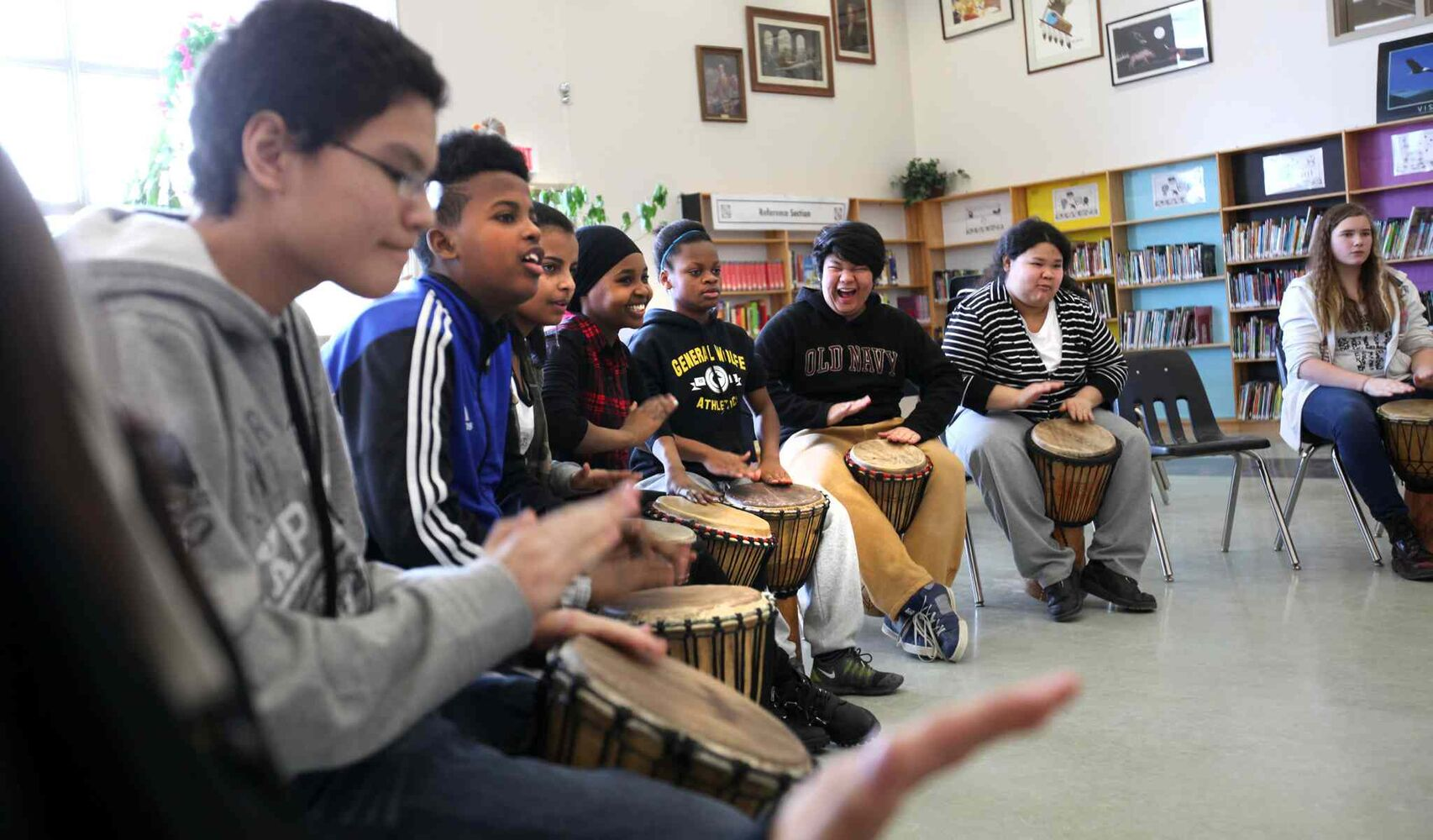 A broad spectrum of students, from refugees to indigenous Canadians, learn to drum together at General Wolfe School Tuesday morning.   (Ruth Bonneville / Winnipeg Free Press)