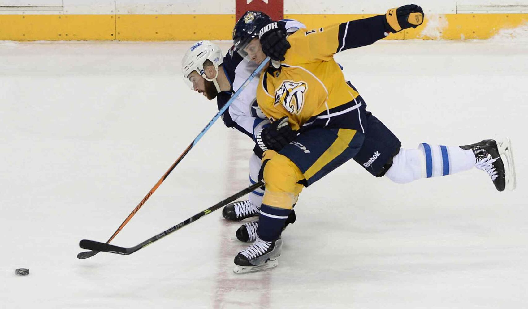 Winnipeg Jets right wing Anthony Peluso, back, and Nashville Predators left wing Gabriel Bourque battle for the puck in the first period. (Mark Zaleski / The Associated Press)