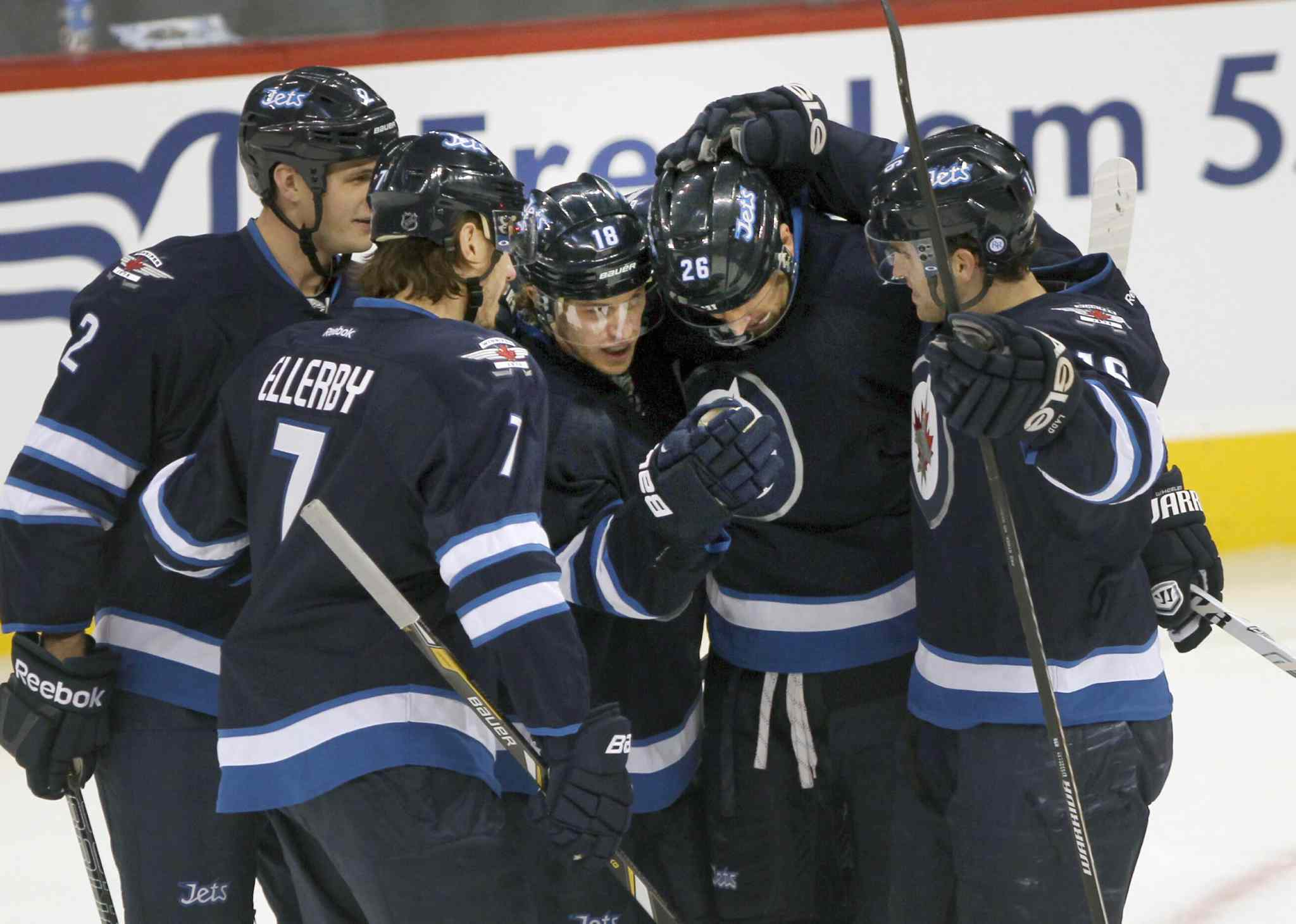 Winnipeg Jets Bryan Little (centre) is congratulated by teammates (from left) Adam Pardy, Keaton Ellerby, Blake Wheeler, and Andrew Ladd after his first-period goal.
