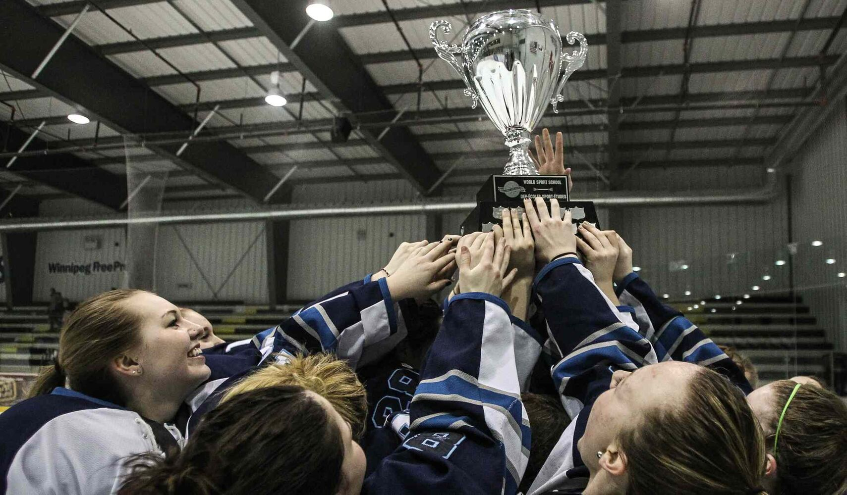 The Shaftesbury Titans celebrate their championship. (MIKE DEAL / WINNIPEG FREE PRESS)