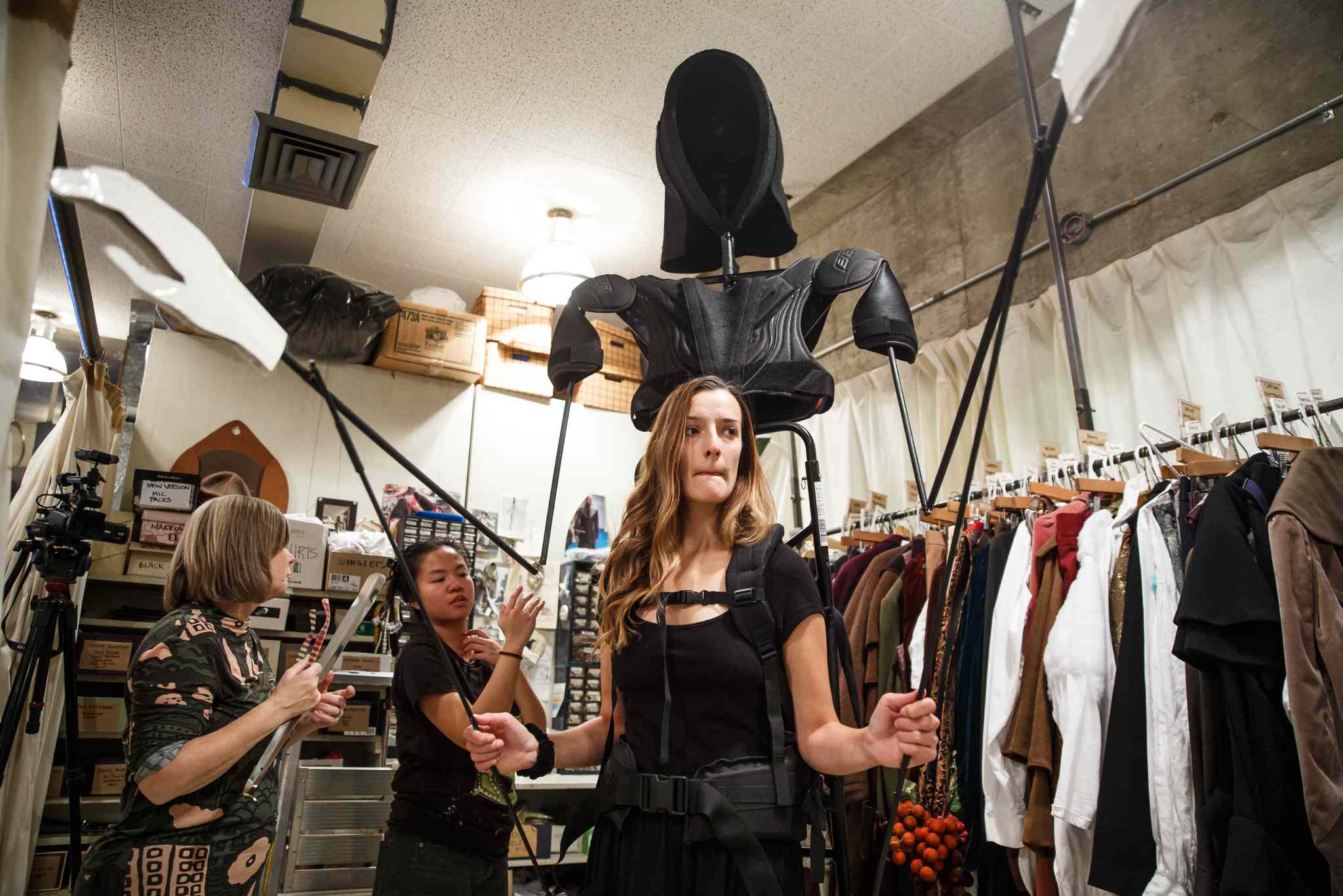 Costume designer Judith Bowden (left) and properties builder Eva Kuodiscuss the construction of the Ghost of Christmas Future while actress Lindsay Johnson watches. (Mike Deal / Winnipeg Free Press)