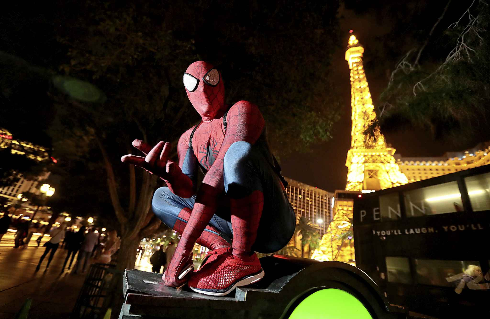 Derrick Tupper, from Houston, Texas, is a Spider-Man character near the fountain at the Bellagio.