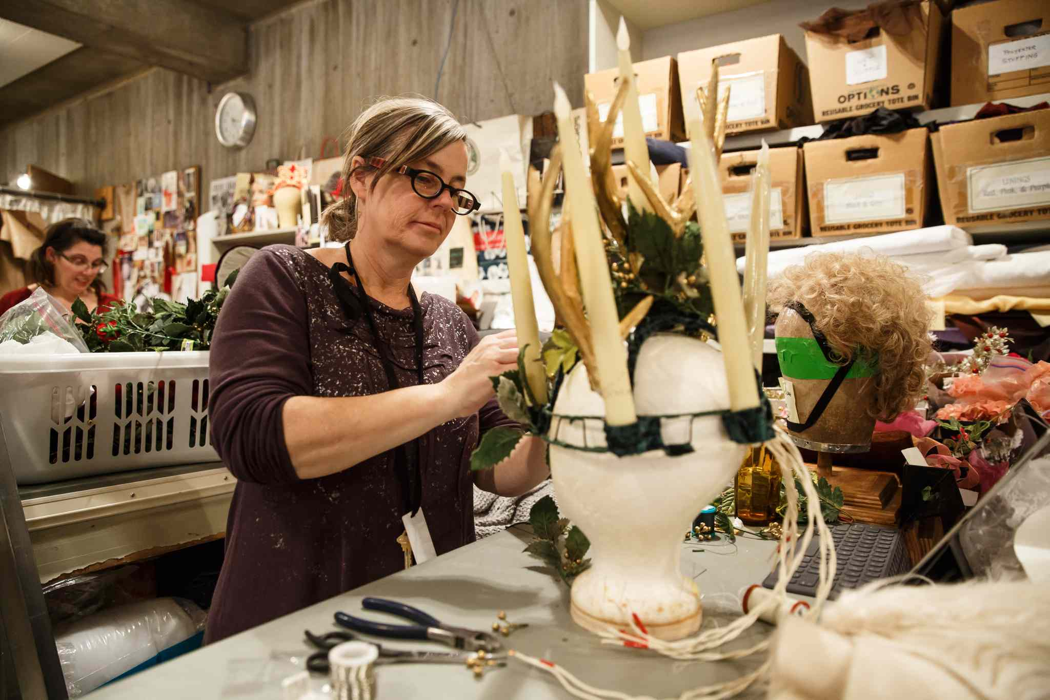 Costume designer Judith Bowden builds the head piece for Ghost of Christmas Present. (Mike Deal / Winnipeg Free Press)
