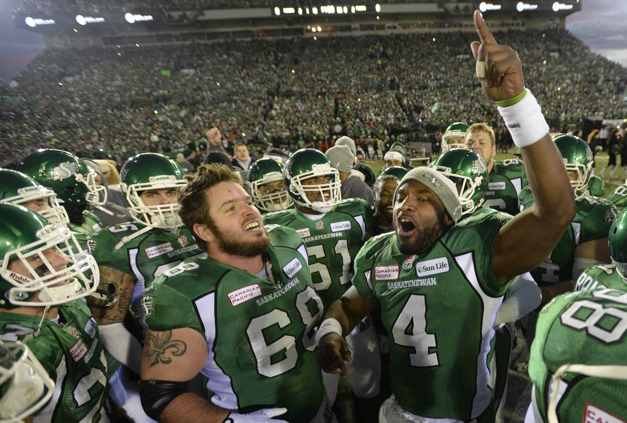 Saskatchewan Roughriders quarterback Darian Durant (4) leads his team on the field.