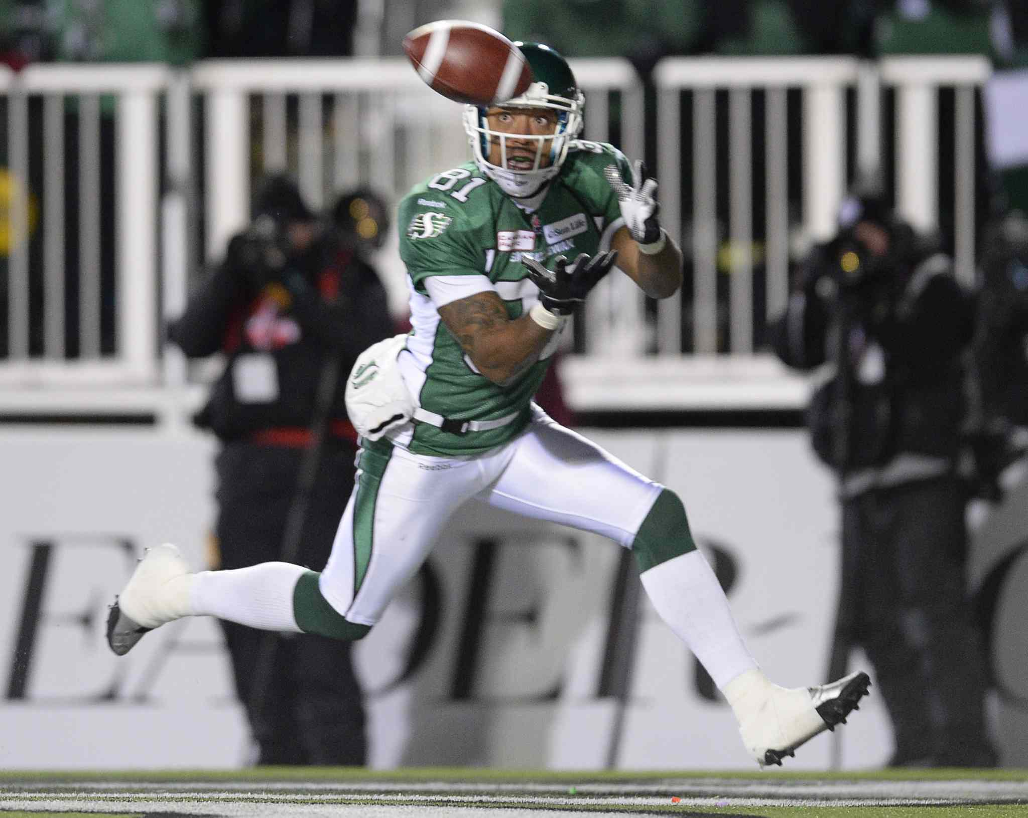 Saskatchewan Roughriders slotback Geroy Simon catches the ball in the end zone for a touchdown as they face the Hamilton Tiger-Cats during first quarter of the Grey Cup Sunday November 24, 2013 in Regina. THE CANADIAN PRESS/Frank Gunn