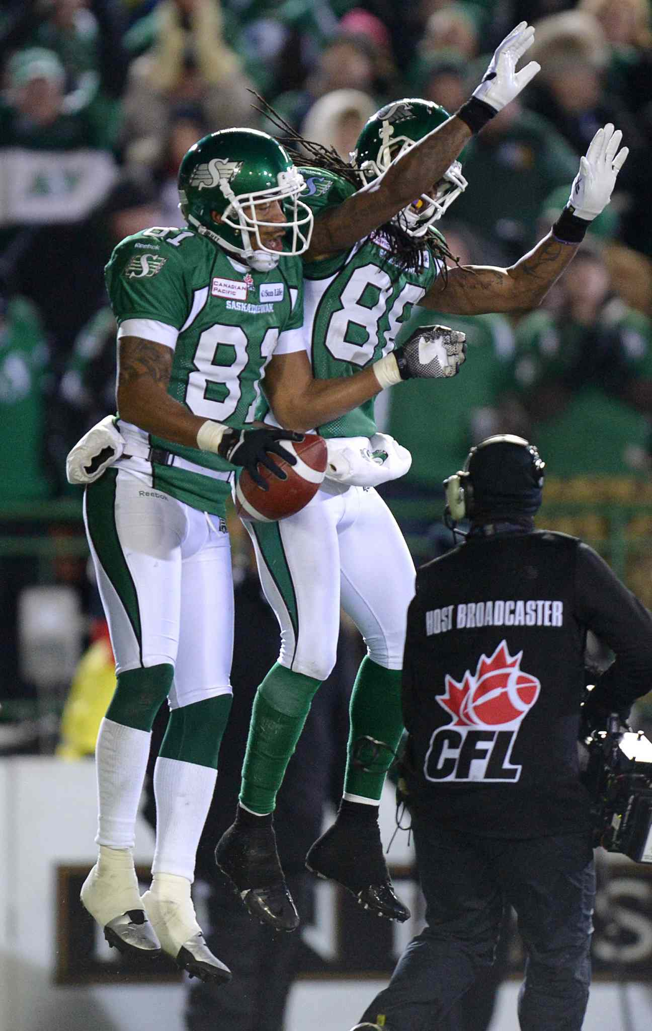 Saskatchewan Roughriders slotback Geroy Simon (left) celebrates his second touchdown against the Hamilton Tiger-Cats with teammate wide receiver Taj Smith during the second quarter.