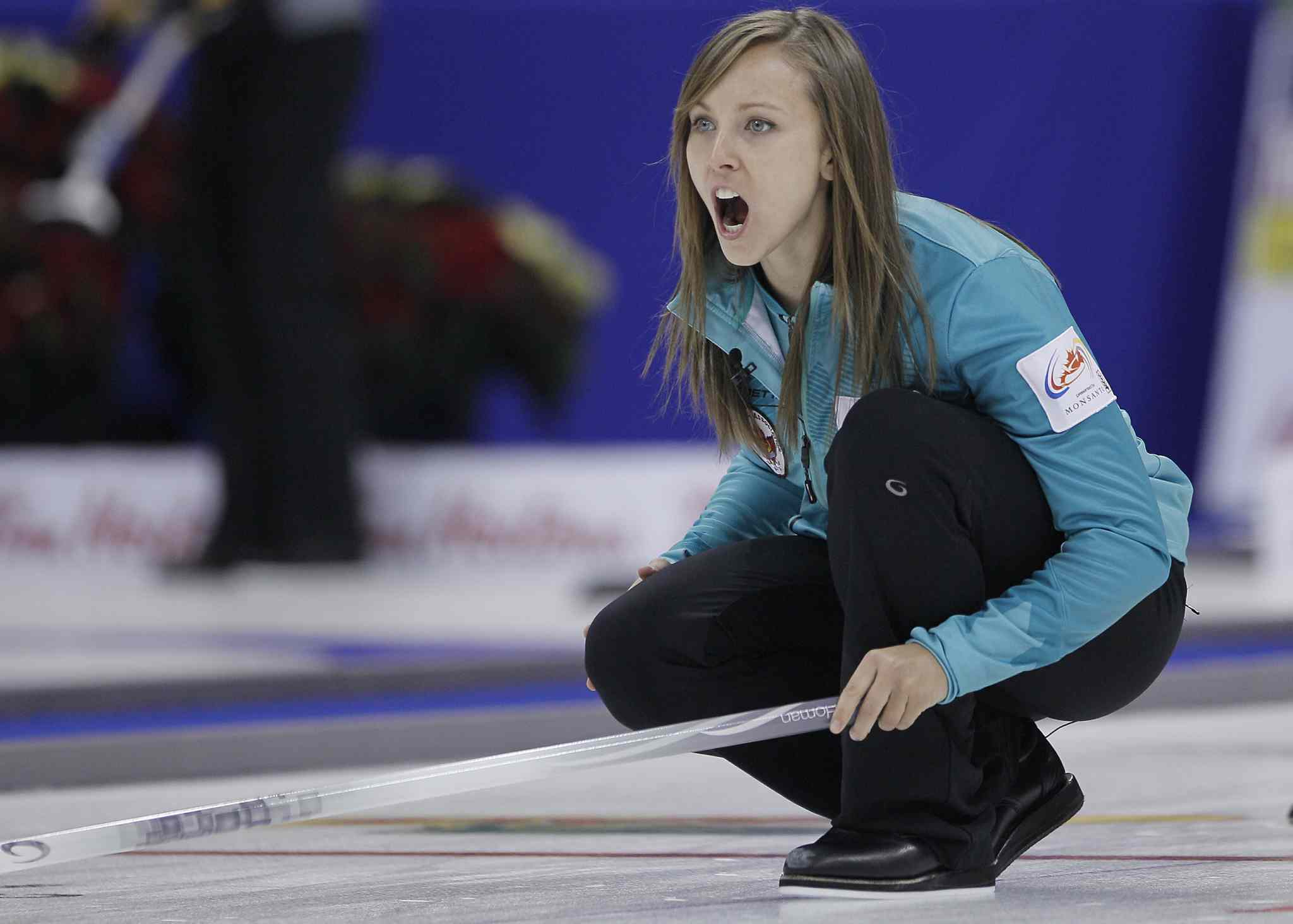 Skip Rachel Homan yells to her sweepers during her opening women's draw against Val Sweeting. Homan fell to Sweeting's rink 10-3.