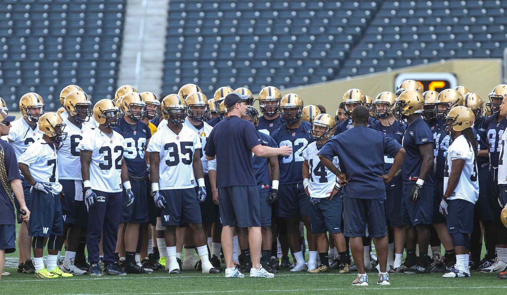 Head coach Mike O'Shea talks to the team during the first official day of the Winnipeg Blue Bombers training camp at Investors Group Field Sunday morning. (MIKE DEAL / WINNIPEG FREE PRESS)