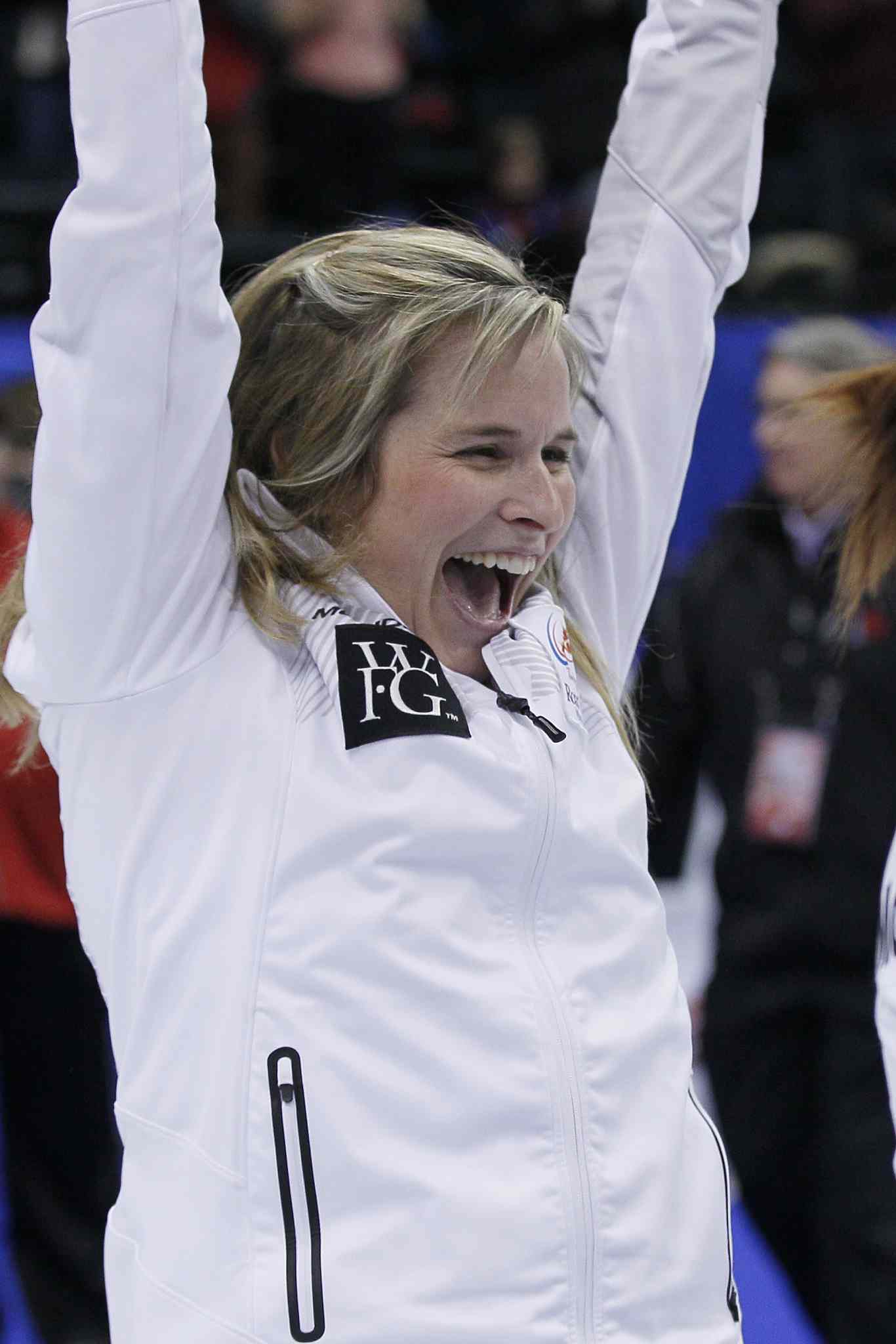 Skip Jennifer Jones celebrates beating Sherry Middaugh in the women's final at the 2013 Roar of the Rings Canadian Olympic Curling Trials.