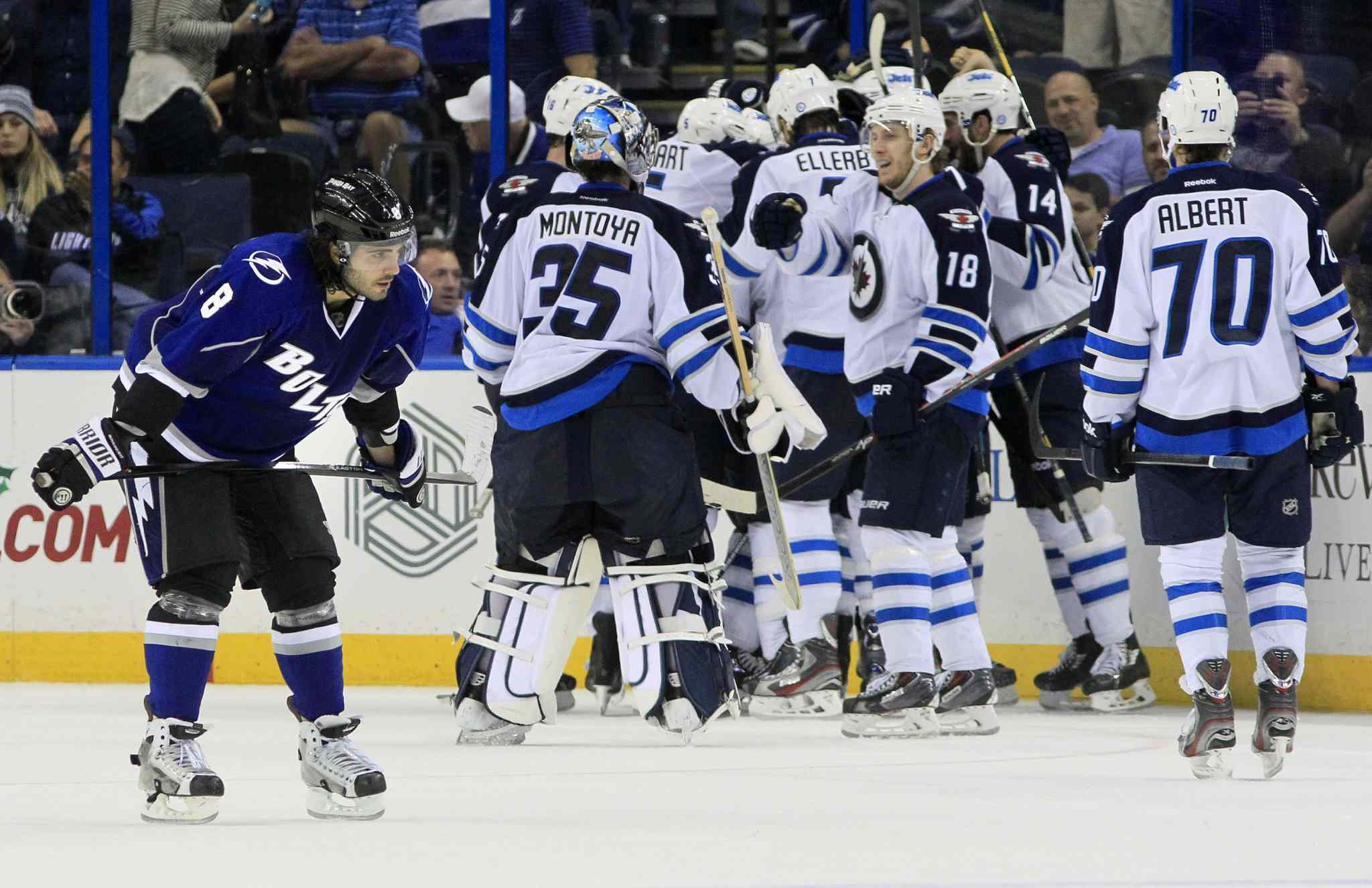 The Tampa Bay Lightning's Mark Barberio (left) skates off as the Winnipeg Jets celebrate their game-winning overtime goal for a 2-1 win.