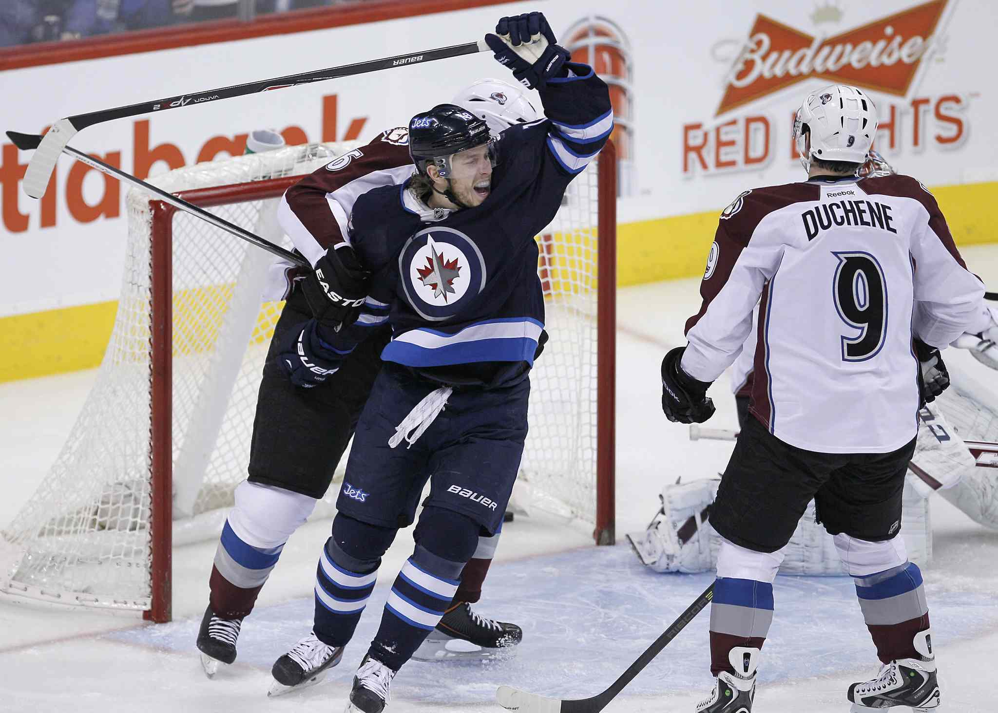 Bryan Little (centre) celebrates Blake Wheeler's early first-period goal as Erik Johnson (left) and Matt Duchene look on.