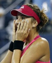 Belinda Bencic, of Switzerland, reacts after her upset victory over Jelena Jankovic, of Serbia, in the fourth round of the 2014 U.S. Open tennis tournament, Sunday, Aug. 31, 2014, in New York. Bencic won 7-6 (6), 6-3.(AP Photo/Elise Amendola)