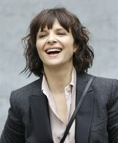 French actress Juliette Binoche poses prior to the start of the Giorgio Armani women's Spring Summer 2015 collection, part of the Milan Fashion Week, unveiled in Milan, Italy, Saturday, Sept. 20, 2014. (AP Photo/Antonio Calanni)