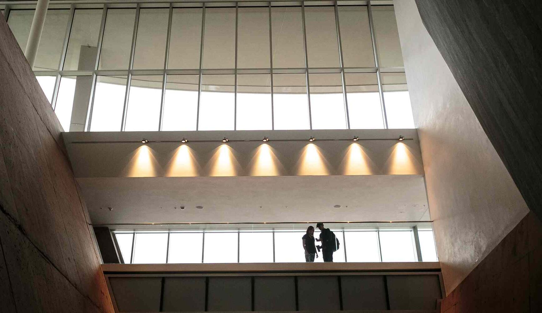 A couple on the walkway above the main entrance during the public's first look inside the Canadian Museum for Human Rights on Saturday. Thousands had reserved tickets for the four gallery preview tour on Saturday and Sunday. That is only four of 11 galleries, the rest of which open Sept. 27. (Melissa Tait / Winnipeg Free Press)