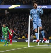 Manchester City's David Silva celebrates after scoring during the English Premier League soccer match between Manchester City and Leicester City at the Etihad Stadium, Manchester, England, Wednesday March 4, 2015. (AP Photo/Jon Super)