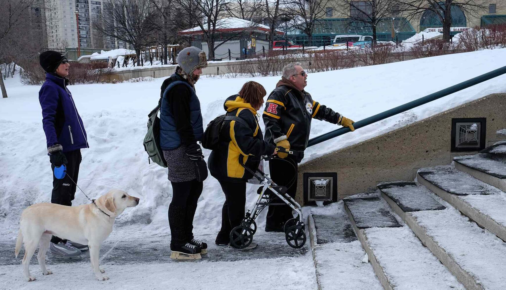 A small line forms as Tom needs to use the hand rail to get up the stairs at The Forks. MIKE DEAL / WINNIPEG FREE PRESS