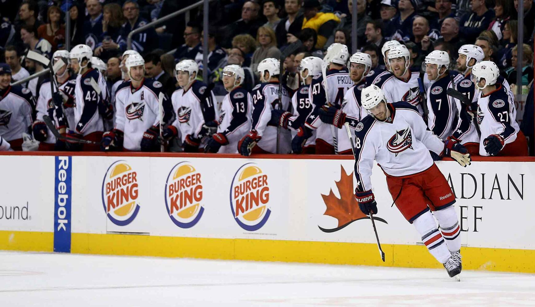 Columbus Blue Jackets' Boone Jenner (38) celebrates with his team after he scored a penalty shot goal against Winnipeg Jets' goaltender Ondrej Pavelec (31) in the second period at MTS Centre. (Trevor Hagan / Winnipeg Free Press)