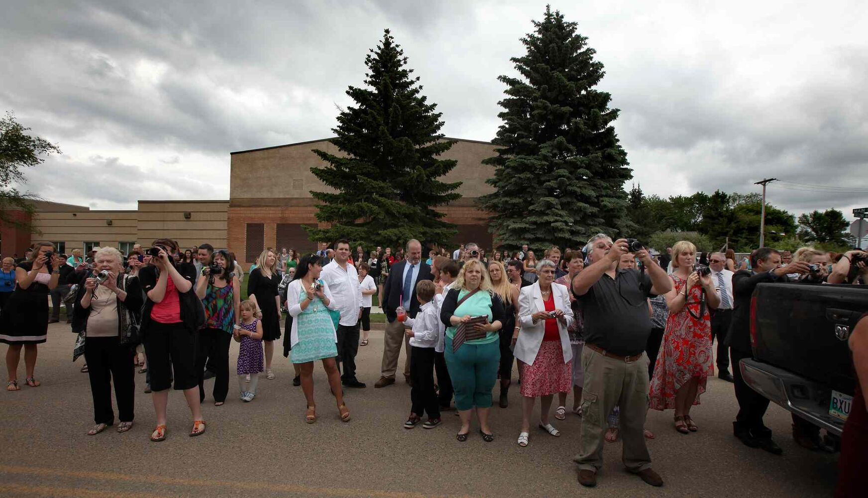 Parents gather to capture their children's high school graduation day in Carberry on Wednesday.