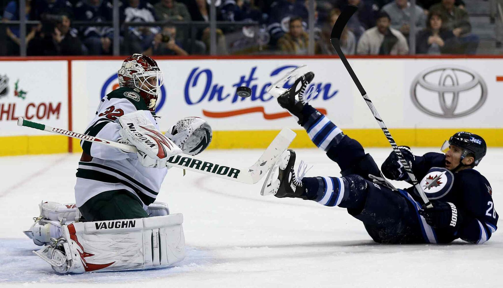 Minnesota Wild goaltender Niklas Backstrom watches a puck as Blake Wheeler slides on the ice during the second period. (TREVOR HAGAN / WINNIPEG FREE PRESS)