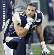 Dejected Winnipeg Blue Bomber Pierre-Luc Labbe takes a knee after another disappointing loss at Investors Group Field.