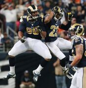 St. Louis Rams defensive tackle Aaron Donald, left, celebrates with safety Rodney McLeod after Donald sacked Broncos quarterback Peyton Manning for a 12-yard loss in the fourth quarter of an NFL game between the St. Louis Rams and the Denver Broncos on Sunday, Nov. 16, 2014, at the Edward Jones Dome in St. Louis. (AP Photo/The St. Louis Post-Dispatch, Chris Lee) EDWARDSVILLE INTELLIGENCER OUT, THE ALTON TELEGRAPH OUT