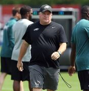 Eagles' head coach Chip Kelly watches during the Philadelphia Eagles Training Camp at the NovaCare Complex in Philadelphia on Sunday, July 27, 2014. (AP Photo/Philadelphia Daily News, David Maialetti) THE EVENING BULLETIN OUT, TV OUT; MAGS OUT; NO SALES