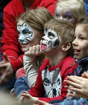 At left, Taylor Winslade,10 and her brother Aidan,6, enjoy the performance of juggler Mike Battie part of the 15th annual Festival of Fools at The Forks Monday. Throughout spring break week, circus and trapeze workshops and performances start at 11:30 a.m.