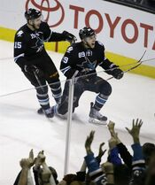 San Jose Sharks left wing Barclay Goodrow, right, is congratulated by James Sheppard after scoring during the third period of the Sharks' NHL hockey game against the Edmonton Oilers on Thursday, Dec. 18, 2014, in San Jose, Calif. San Jose won 4-3. (AP Photo/Eric Risberg)