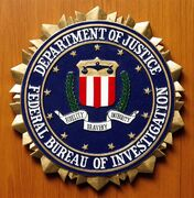 The crest of the Federal Bureau of Investigation of the Department of Justice of the United States of America is pictured at the embassy of the USA in Berlin, Germany, Aug. 10, 2007. THE CANADIAN PRESS/AP, Michael Sohn