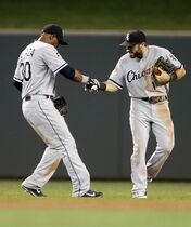 Chicago White Sox' Adam Eaton, right, and Alejandro De Aza celebrate after they defeated the Minnesota Twins 5-2 in a baseball game on Thursday, July 24, 2014, in Minneapolis. (AP Photo/Jim Mone)