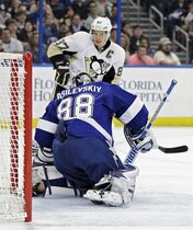 Tampa Bay Lightning goalie Andrei Vasilevskiy (88), of Russia, makes a save on a shot by Pittsburgh Penguins center Sidney Crosby (87) during the first period of an NHL hockey game Tuesday, Dec. 23, 2014, in Tampa, Fla. (AP Photo/Chris O'Meara)
