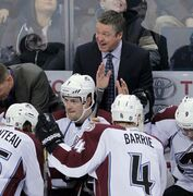 Colorado Avalanche head coach Patrick Roy gives his players instructions during Thursday night's game at the MTS Centre.