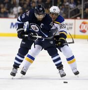 Jets captain Andrew Ladd battles with the St. Louis Blues' Alexander Steen: Steen's pass to break David Backes for a power-play goal was a back-breaker Sunday.