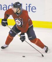 Winnipeg Jets defenceman Grant Clitsome leans into a shot during practice Thursday.