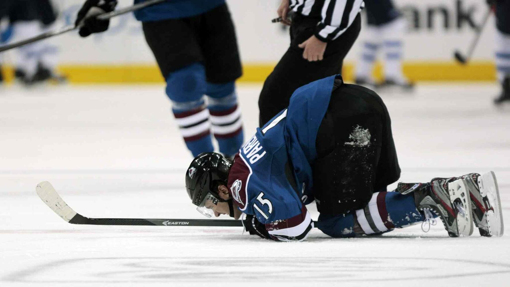 Colorado Avalanche winger P.A. Parenteau kneels on the ice after after getting hurt during the second period. He left the game and did not return. (Joe Mahoney / The Associated Press)