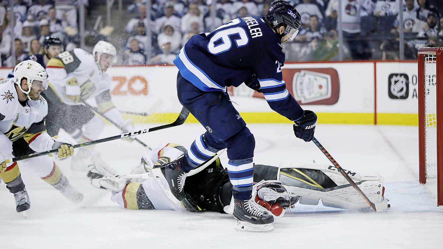 JOHN WOODS / THE CANADIAN PRESS</p><p>Winnipeg Jets' Blake Wheeler (26) beats Vegas Golden Knights goaltender Marc-Andre Fleury (29) but misses the open net during second period of game one action in the NHL Western Conference Final in Winnipeg on Saturday, May 12, 2018.</p>