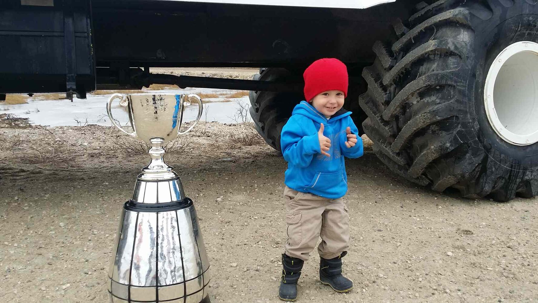 This little guy can't contain his excitement to meet the Grey Cup, posing for a picture using both the thumbs up and hang-loose signs.  (Jeff Hamilton / Winnipeg Free Press)