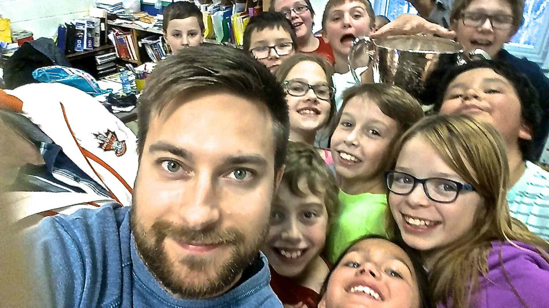 Winnipeg Free Press sports reporter Jeff Hamilton poses for a selfie with Grade 5 and 6 students at Joseph H. Kerr School in Snow Lake. The trophy was in town as part of an eight-day tour through northern Manitoba to help promote the Grey Cup game in Winnipeg this year.
