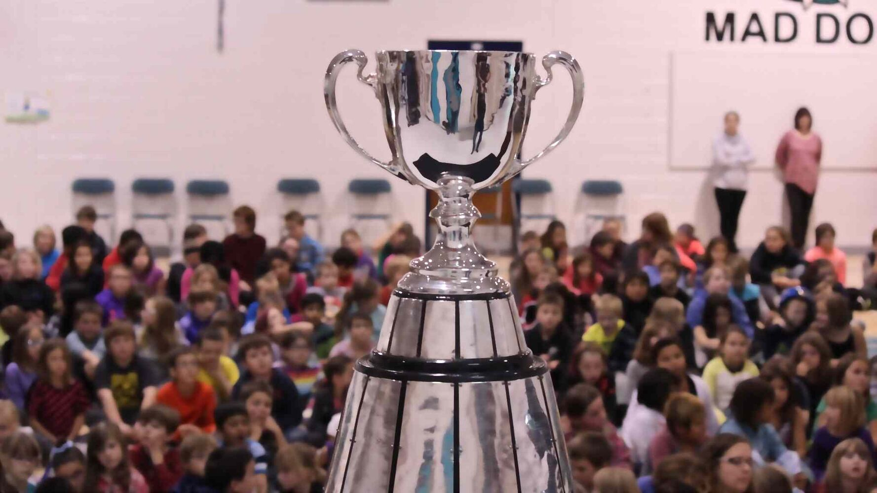 The Grey Cup made its way to McIsaac School in Flin Flon. The trophy was in town as part of an eight-day tour through northern Manitoba to help promote the Grey Cup game in Winnipeg this year. (Jeff Hamilton / Winnipeg Free Press)