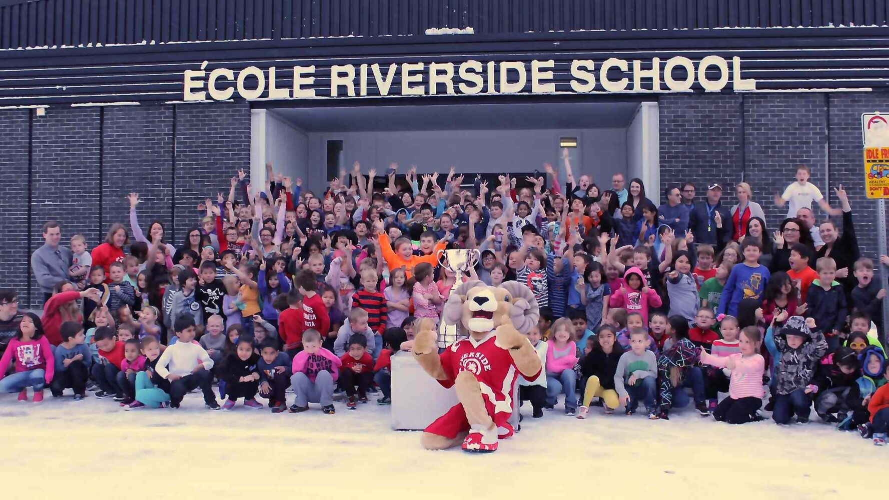 Students at Riverside School in Thompson brave the cold to shoot a group pic with the Grey Cup. The trophy visited seven schools in total that day and included a visit from former Bombers players Doug Brown and Brett MacNeil, who spoke about the importance of getting a good education, as well as the effects of bullying.  (Jeff Hamilton / Winnipeg Free Press)