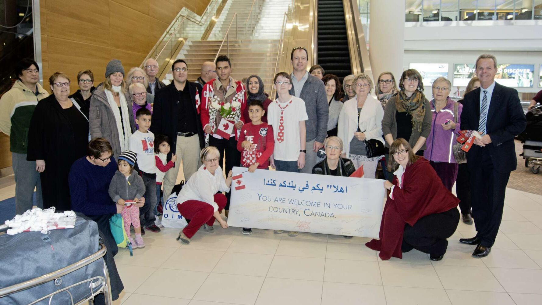 The South Osborne Syrian Refugee Initiative welcomed Tarek Al Abdellah (centre, holding flowers) to Winnipeg on Oct. 25. He is the first of 13 people the group has sponsored to arrive in Canada. (Danielle Da Silva - Sou'wester)