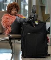 Scarlett Newman, 24, waits patiently for her mother's flight to arrive at Raleigh-Durham International Airport Tuesday, Dec. 23, 2014, in Durham, N.C. Newman had just arrived from New York and was meeting her mom to continue on to Fayetteville to celebrate the holidays with friends and relatives. (AP Photo/The News & Observer, Chuck Liddy)