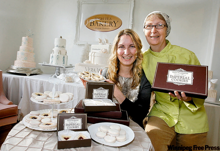 Belinda (left) and her mother Carol Bigold display samples of their Imperial cookies, which will be at the Golden Globe Awards.